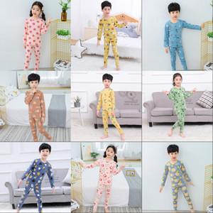 Unicornio Impreso Pijama Dibujos animados Dinosaurio Manga Larga Tops Tops Pantalones Sleepwear Boy Girl Childrens 2pcs Set Clothing 22 2SD G2