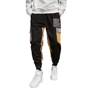 Hombres Black Joggers Casual Pantalones Cintas Hombres Big Bolsets Harem Pantalones de carga Hombre Primavera Streetwear Monos Sweetpants