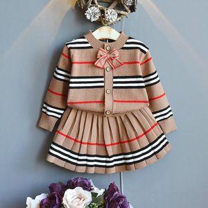 2020 anni Abbigliamento per bambini Abbigliamento per bambini Camicia da ragazza + Gonna Coreano College Bambini Vento Autumn Autumn Girl Autunno Maglione Bambino Abito a pieghe a strisce