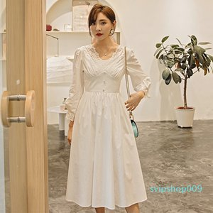 YIGELILA Autumn New Arrivals White Dress V-neck With Button Backless Dress Lantern Sleeves A-line Elegant Mid-calf 65274