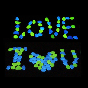 100pcs / lot de pierres lumineuses lueur dans des cailloux décoratifs sombres pelouse aquarium jardin fluorescent fluorescent stones décoratifs dd chaud vente m2