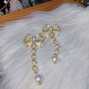 Hohe qualität perle ohrringe bogen bindungen diamant baumeln thread übertriebene ohrringe mode elegent long silber party perlen ohrring frauen