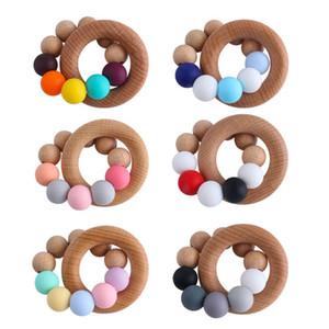 Neue DIY Natürliche Holz Baby Zähne Neugeborene Zähne Praxis Spielzeug Training Handgemachte Ring Silicium Perlen Schnuller B3782