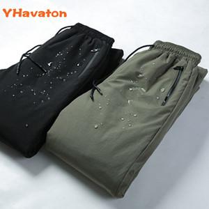 Yhavaton 4xl mens 90% bianco a prova di freddo inverno dritto esterno indossare pantaloni business caldi anatra abbagliante pantaloni imbottiti