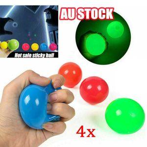 1pcs 스틱 벽 형광 스쿼시 크리스마스 스티커 객관적인 공 감압 Gooi Fidget Kids toxin Stress Relief Toys CZQ5