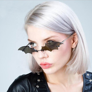 Sunglasses European and American trends personalized trimming frameless Sunglasses exaggerated bat Shaped Sunglasses