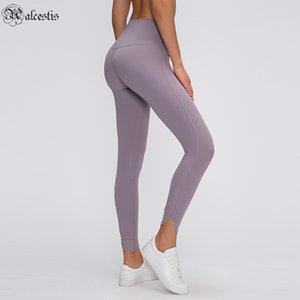 Leggings de remise en forme Lumière et mince Corps en forme de couleur solide Poche de la hanche Nine Point Fitness Pantalon Diagonal High Taille Pants de yoga