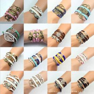 30pcs 283 Designs Leather Bracelet Antique Cross Love Peach Heart Owl Bird Believe Pearl Knitting Bronze Charm Bracelets