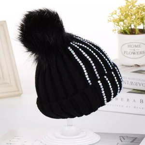 Autumn and winter baby hats for boys and girls hair ball knitted hats point drill ear caps cute warm parent-child hats