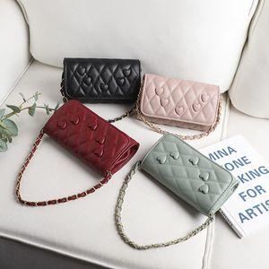 new designer shoulder bag heart-shaped pattern woven handle rhombus magnetic buckle casual shoulder bag diagonal ladies shoulder bag