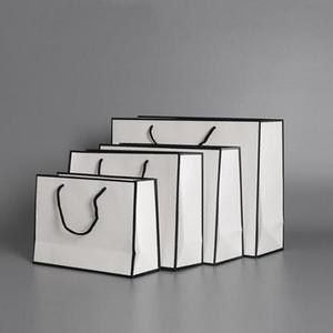 حقيبة ورقة بيضاء أكياس الورق الحاضر كرافت بطاقة التعبئة والتغليف حقيبة القماش أزياء تخزين حقيبة يد مع مقبض سماكة أكياس التسوق ZYY125