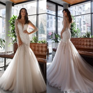 Luxury Mermaid Wedding Dresses Dubai Arab Bling Sequins Beads Appliques Long Sleeves Bridal Gowns Sexy Illusion Robe De Mariee