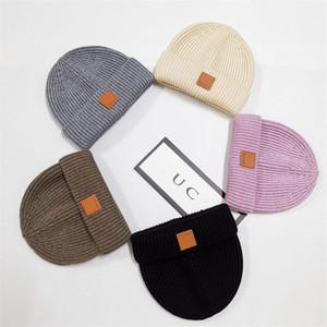 Унисейные шапочки зимние вязаные шапки модный дизайнерские шапки череп классические лейблы вязание крючком шляпу капота мода вязать крышка открытый теплый ушной муфс шапочка Xmas