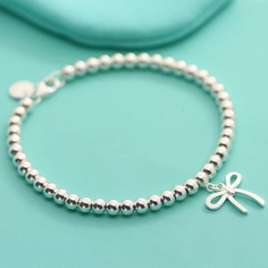 Tiff 925 sterling silver classic bow bead bracelet is suitable for women to use in social occasions.