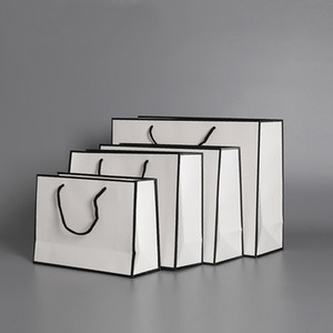الأبيض أكياس الورق الحاضر كرافت بطاقة التعبئة والتغليف حقيبة القماش الأزياء تخزين حقيبة يد سماكة التسوق الإعلان مخصص HH9-3619