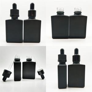 Квадратный стеклянный парфюмерные бутылки 30 мл замораживающая твердая черная эфирная бутылка для бутылки бутылки бутылки прямоугольный дом Высокое качество 1 1YB M2
