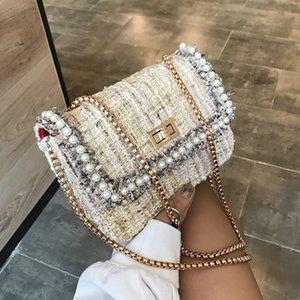 Diseño de lujo de las perlas de lana cadena de las mujeres bolsas de crossbody 2020 Fashon Señoras Hombro Mensajero Bolsa de Mensajero Embrasos Hombre Monederos Hand