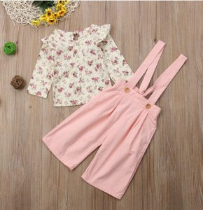 The new children's baby girls wear long-sleeved floral shirt + strap models fall straight jeans long-sleeved two-piece suit
