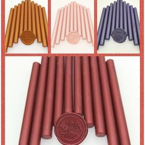 Nuevos 6 colores 30pcs / pack equipos de oficina barra de palo redondo y tarjeta de invitación de la boda del sello de la cera de pegamento uso de armas Q1114