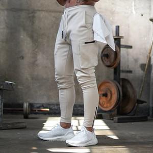 Pantalones deportivos de jogger para hombre Pantalones de pista flaca de moda Pantalones de diseño de cremallera Sweypants Hombre Gimnasios Entrenamiento Fitness Pantalones de algodón Masculino Y1114