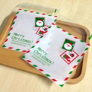 Cadeau cadeau 50pcs Noël blanc couleur frontière frontière enveloppe de biscuits à la main dessin animé santa timbre DIY cellophane auto-bâton goodie