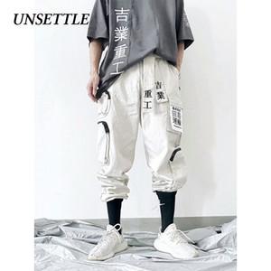 Unsettle Japón 2019 Hip Hop Joggers hombres / mujeres Harem Multi-bolsillo pantalón casual para hombre de Calle Pantalones Cargo