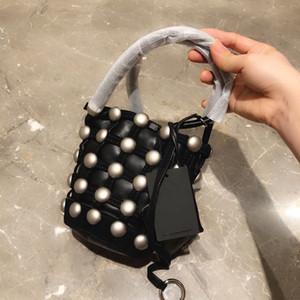 Chinese minority designer King rivet bucket bag goatskin handbag high quality girls' handbag