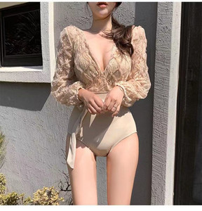 Female designer new one body swimsuit female long sleeve slim body looks sexy, conceals belly, beach hot spring vacation bikini