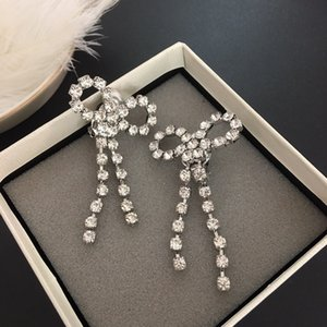 Net red same bow tassel earclip exaggerated luxury Diamond Earrings ins