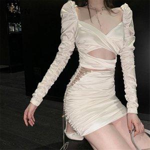 Sexy Bandage Bullcon Robe Femme Coréen Tunique Satin Satin Mini Robe Automne Diamond Chaîne plissée Slim Hollow Out Club