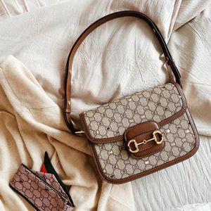 Nini Xiaozhan Same 2021 New Fashion 1955 Buckle Saddle Women's Slanting Leather Postman's Shoulder Bag