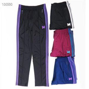 Иглы для спортивных штанов Мужчины Хип-хоп Женщина внутри синего тега Бабочка Дады бархатные брюки OQXK