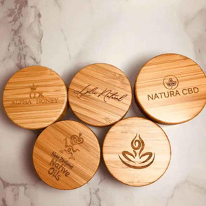 Bamboo eco friendly lotion container 30ml 50ml 100ml bamboo cosmetic packaging face cream black glass jar with wood lid