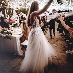 Sexy Backless Summer Beach Wedding Dresses 2021 Spaghetti Straps Long Ivory Tulle Country Boho Wedding Dress Bridal Gowns Top Lace Appliques
