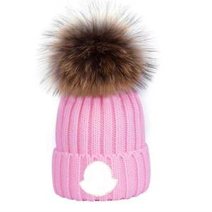 Wholesale beanie новые зимние колпачки шляпы женские капоты утолщенные шапочки с реальным енотным мехами помпоны теплые девушки кепки pompon beanie бесплатная доставка