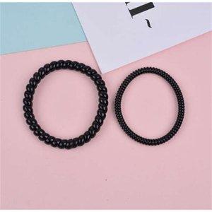 50 piezas de pequeño anillo negro Cuerda de goma Cuerda de la línea telefónica de traceless Banda de pelo 3