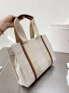2021 Новый модный и изысканный и изысканный теленокскин холст сумка темперамент леди сумка сумка коммутарная сумка высокого класса качества супер ca