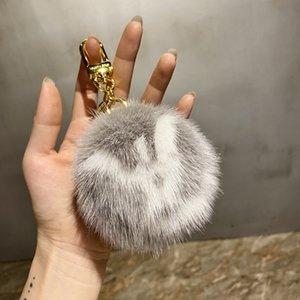 2021 Fluffy Raccoon Fur Ball Keychain Real Fur Key Chains Pompom Keychain Pompon Keyring Charm Women Bag Pendant