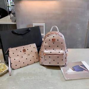 Новые боковые заклепки рюкзак мода большая емкость путешествий сумка сумка. Как мужчины, так и женские школьные сумки для девочек-подростков высокого качества
