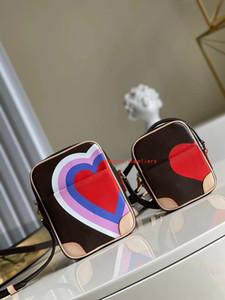 M57450 لعبة على حلقة نمط حقيبة الأزياء حقائب متعددة pochette الملحقات المحافظ النساء المفضلة مصغرة pochette 2 قطع الملحقات حقيبة crossbody