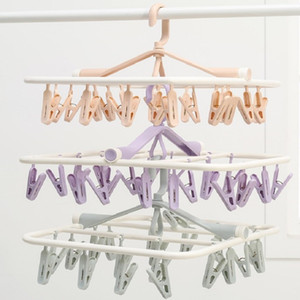 To a Folding Multi Clip Plastic Clothes Hanger, a Clothes And Socks Drying Rotary Hanging Clothes Hanger.