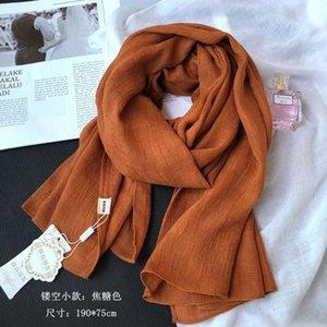 Spring autumn winter cotton hemp scarf women's turmeric Beige pure color hollow grid Korean literature and art long shawl silk