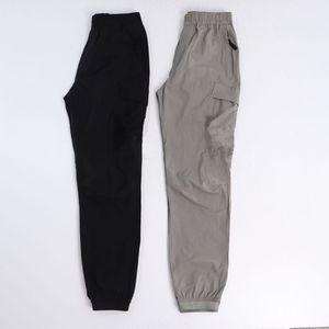 Konng Gonng الربيع والصيف السراويل الرجال الأزياء العلامة التجارية الرجعية متعددة جيب وزرة الركض طماق التعادل قدم واحد