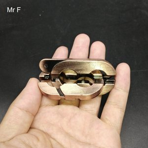 Copper Color Cast Metal Puzzle Educational Magic Game Brain Teaser Toy ( Model Number H544 )