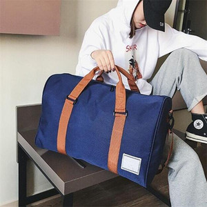 Nouvelle toile Sacs de voyage Femmes Hommes Grande capacité Pliant Duffle Bag Organisateur Emballage Cubes Girl Girl Girl week-end