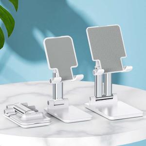 Live broadcast mini portable folding telescopic desktop silicone anti slip mobile phone bracket gift