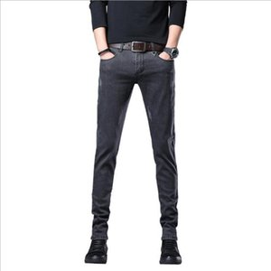 Jeune petite jambe hommes printemps et été nouvelle version coréenne mince vieux lavage usage jeans pantalon mode tendance usure hommes k08