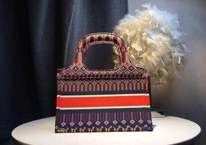 2021 حار بيع الأزياء الفاخرة حقيبة يد المرأة محفظة قماش حمل حقيبة صغيرة عالية الجودة الجملة لون الطباعة شعار حمل حقيبة القابض