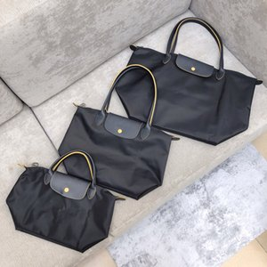حقائب نسائية المحافظ التسوق كبير حمل حقائب الشاطئ pochette نايلون حقيبة يد أكسفورد حقيقي جلد أعلى جودة حقيبة سفر قابلة للطي