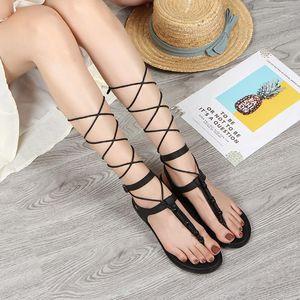 Luxury designer designs fashion casual sandals women's new belt elastic strap buckle flat strap flat shoes